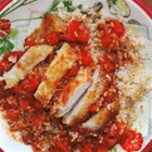 Chicken Cacciatore Rice Bowl - Bite-sized chunks of chicken simmered in a traditional pasta sauce with bell peppers are served over piping hot brown rice.