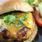 Chicken Cheddar and Guacamole Burgers - Using ground chicken to make burgers topped with guacamole allows the added flavors of jalapeno, garlic, and onion to shine.