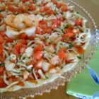 Tangy Shrimp Dip - Tangy and tasty - this creamy shrimp dip with peppers, tomato and cheese is sure to be the best tasting dip at any party. Serve with your favorite crackers or tortilla chips.