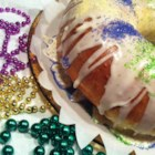 Buttermilk King Cake with Cream Cheese Filling - A big, beautiful king cake with a rich cream cheese filling will start a new Mardi Gras tradition at your house.