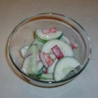 Creamed Cucumber Slices - Cucumber slices are tossed with a creamy dressing.