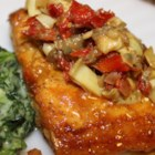 Mahi Mahi with Artichokes and Sun-Dried Tomatoes - This recipe is for pan-fried mahi mahi topped with a white wine reduction with sun-dried tomatoes and artichoke hearts.