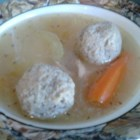 Cogy's World Famous Matzo Balls - Homemade matzo balls have never tasted better than this version made with eggs, matzo meal, chicken stock, a splash of vodka, dried basil, garlic powder, and club soda. Cooked in chicken stock, they're guaranteed comfort food.