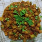 Sweet Potato and Chickpea Masala - Sweet potatoes make a surprisingly delicious addition to a traditional Indian recipe for chana masala.