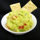 Mom's Awesome Guacamole - Sour cream brings extra creaminess to the 'awesome' guacamole made with this recipe.