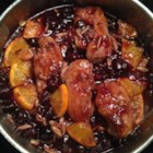 Cherry Chicken - Lightly floured chicken pieces with the sweet flavoring of dark cherries and orange slices make a great entree that can be served over rice or alone with a salad for a lighter meal. Boneless pieces can be used if desired.