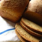 Danish Spiced Rye Bread (Sigtebrod) - Danish spiced rye bread is a wonderful addition to any holiday table. Enjoy with butter and jam at breakfast, use for sandwiches, or serve with dinner as a part of a winter feast. The spices in this bread are sure to make it a family favorite and tradition.
