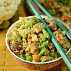 Cauliflower Fried 'Rice' - Enjoy this cauliflower fried 'rice' packed with green onions, peas, eggs, pork, and garlic.