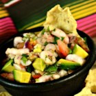 Pico de Gallo with Avocado and Shrimp - Pico de gallo with the addition of avocado and shrimp is a hearty dip with a lot of flavor. Serve with tortilla chips!
