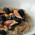 Brown Rice Breakfast Porridge - Leftover brown rice is cooked together with milk, honey, and dried blueberries for a healthy, new twist on breakfast.  Experiment with it to make it your own, you can try using any mixture of dried fruit instead of the blueberries.