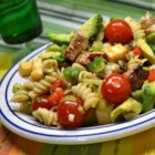 Chicken Club Pasta Salad - All the fixings for a chicken club sandwich are folded together with pasta and a creamy Italian dressing for a quick and easy lunch.