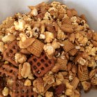 Caramel Corn Snack Mix - A candied take on traditional Chex Mix, this crunchy munch blends salty pretzels, popcorn and pecans with vanilla and other sweet flavorings.