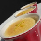 Aunt Mariah's Lemon Sponge Cups - A light, lemony batter separates into a lemon custard topped with a layer of lightly browned sponge cake in this budget-friendly and delicious dessert that's great served warm with whipped cream.