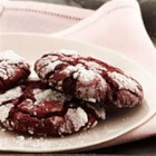 Red Velvet Crinkle Cookies - A deep red, chewy cookie that has a delicate crackled crust dusted with a touch of powdered sugar.