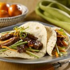 Asian Tacos - These Asian-inspired chopped steak tacos are served with a cucumber and carrot slaw in ginger, soy and orange dressing.