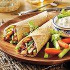 Buffalo Chicken Tacos from Mission(R) - Spicy grilled chicken breast slices are rolled into tortillas with strips of bell pepper and red onion. Serve carrot and celery sticks with blue cheese dressing on the side for dipping.