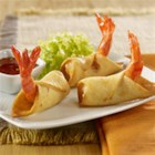 Firecracker Shrimp Taquitos - Spicy jumbo shrimp are wrapped in a tortilla triangle with a tail 'handle,' then deep fried for these delicious appetizer bites.