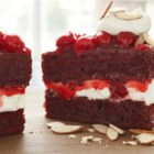 Red Velvet Cherry Torte - Red Velvet Cherry Torte garnished with icing and toasted almond slivers create this easy and delicious cake.