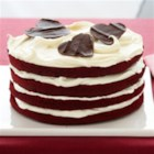 Red Velvet Dream Torte - Layers of rich Red Velvet Cake with decadent cream cheese frosting are topped with chocolate hearts for an added, loving touch.