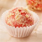 Strawberry Cheesecake Truffles - Try these delicious Strawberry Cheesecake Truffles with the new Duncan Hines(R) Strawberry Flavoured Cupcake Mix. The cake mix, cream cheese frosting mix, and a pastry bag are all included in the box.
