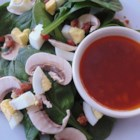 Wilted Spinach Salad and Bacon Vinaigrette - Spinach, mushrooms, and hard-boiled egg are tossed with a warm bacon vinaigrette creating a hearty and satisfying salad.