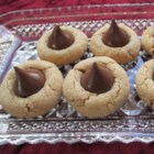 Peanut Butter Blossoms - Press a chocolate kiss into a perfect peanut butter cookie and you have a delicious peanut butter blossom.