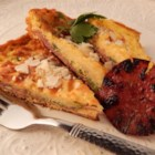 Three Cheese Salami Frittata - This three cheese salami frittata is cut into small squares and can be served as a delightful appetizer alongside a nice glass of white wine.