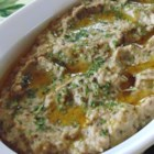 Traditional Baba Ghanoush - This traditional recipe for the classic eggplant dip consists of baked eggplant with garlic, lemon juice, and tahini sauce.