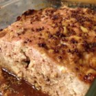 Glazed Tofu Meatloaf - Turkey and tofu are baked into a juicy loaf, and drizzled with a brown sugar and soy sauce glaze.