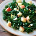 Kale and Feta Salad - Chopped kale tossed with apple cider vinegar, diced apple, currants, pine nuts, and feta cheese makes a refreshing salad.