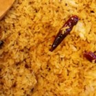 Exotic Indian Tangy Rice - A tangy rice dish made with tamarind and curry leaves has a slightly sour flavor. It is very easy to make and it a favorite food in south India.