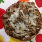 Turkey Portobello Pizza - Portobello mushroom caps make delicious pizza crusts. Topped with a slice of fresh mozzarella cheese and a zesty turkey pesto sauce, these cheese treats are sure to be a hit.