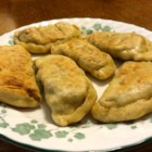 Pierogi from Granny - Beef and pork-filled pierogi make a great traditional Polish meal. This is a recipe my Polish grandmother used to make. Although I don't like a lot of Polish food, this is a family favorite I love. It is a lot easier and faster if two people make it together.