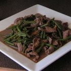 Thit Bo Xao Dau - This quick Vietnamese stir-fry of sirloin tip slices is combined with fresh green beans and served over rice for a one-dish meal. Other vegetables, such as broccoli florets,  could be substituted for the beans.
