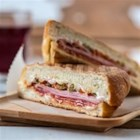 Italian Lovers' Panini - A Southern classic made easy - olive salad with deli meat and cheese, grilled to perfection.