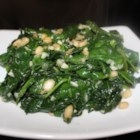 Spinach and Pine Nuts -  Pine nuts seem to add a bit of glamour to just about anything. Here it 's spinach. Garlic, cooked spinach and the pine nuts are cooked in olive oil for a minute or two and seasoned with freshly ground pepper.