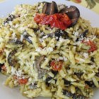 Orzo with Sun-Dried Tomatoes and Kalamata Olives - This mixture of orzo pasta, tomatoes, and olives is flavored with pesto and can be served as a side, a salad, or a vegetarian entree.