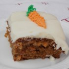 Sister Beth's Carrot Cake - This carrot cake combines carrots, pineapple, and cinnamon with shredded coconut and walnuts for a perfectly delicious cake. Homemade cream cheese frosting provides a smoothness with every bite.
