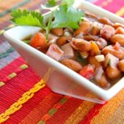 Easy Cowboy Beans (Frijoles Charros) - Pinto beans, diced tomatoes with green chile peppers, and ham are simmered together in this easy cowboy beans recipe. Serve with warm tortillas or cornbread.