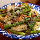 Shrimp and Asparagus with a Louisiana Twist - This recipe uses crushed red pepper for a bit of Louisiana heat in a pasta dish with shrimp, asparagus, and red bell pepper.