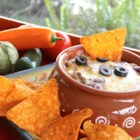 Nacho Typical Nachos - This recipe yields a creamy dip which turns a dipped tortilla chip into something you would normally pull from a pile of nachos.