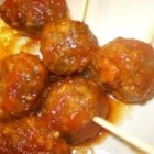 Easy Beer and Ketchup Meatballs - These ARE easy! Beer and ketchup are set in a slow cooker to simmer. Meatballs are baked in the oven, then added to the simmering liquid for three hours.