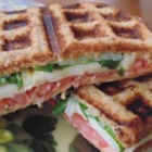 Waffle Sandwich with Cheese, Spinach and Spicy Mustard - Layer all the ingredients for a fancy grilled cheese into a waffle iron for a panini-style waffle sandwich.