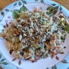 Angel's Cabbage Salad - Start with prepared shredded cabbage to achieve this simple, sweet, and tangy slaw featuring sunflower seeds, almonds, and raisins.