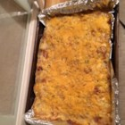 Pork Chop Potato Casserole - A mixture of sour cream, cream of celery soup, and hash brown potatoes is topped with pork chops, Cheddar cheese, and French-fried onions in this main course casserole.