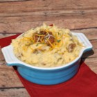 Cheesy Mashed Potatoes with Cubed Ham - This buttery potato dish has plenty of Cheddar cheese and ham.
