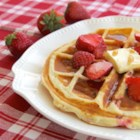 Strawberry Waffles - Quick and easy waffles flecked with strawberries are a colorful and tasty way to start weekdays or weekend mornings. Serve warm with maple syrup.