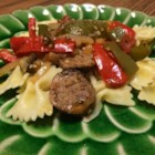 Sweet Sausage Marsala - This is a great Italian dish that doesn't require a lot of work. Sweet Italian sausage is cooked with onions and green and red bell pepper, and seasoned with Marsala wine and a pinch of oregano.