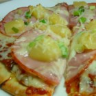 Fast Hawaiian Pizza - A quick and easy ham and pineapple pizza is built on a flour tortilla and doesn't need the oven. It's started on the stove and finished in a toaster oven.