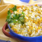 Yum-Yum Corn - Corn baked with an irresistible combination of butter, cream cheese, and garlic. Every time I make this for other people, they ask for the recipe. Just one taste and everyone says 'YUM!' Especially a favorite with my kids!